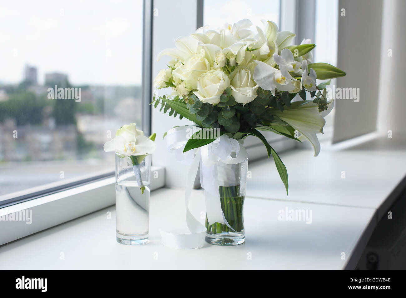 Beautiful Wedding Bouquet In A Glass Vase Flowers On White Stock