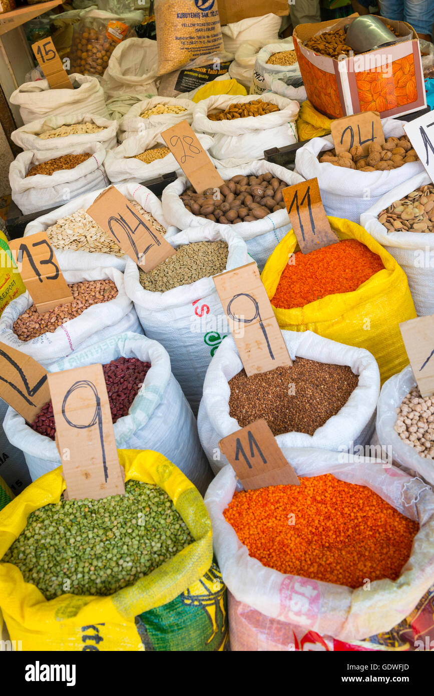 Israel Netanya market typical stall with sacks of lentils broad & kidney beans pulses walnuts pecans almonds - Stock Image