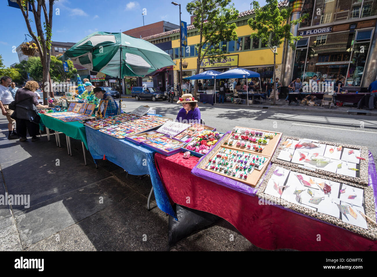 Street vendors selling handmade crafts on tables along Telegraph Hill on University of California at Berkeley college - Stock Image