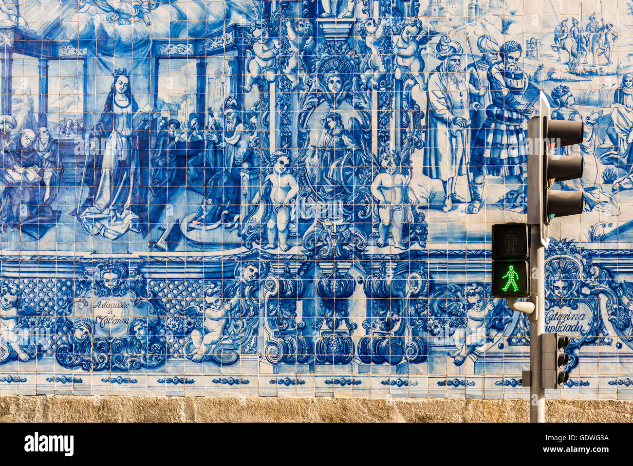 Traditional azulejos hand-painted tiles covering the exterior wall of the Capela das Almas church in Porto, Portugal - Stock Image