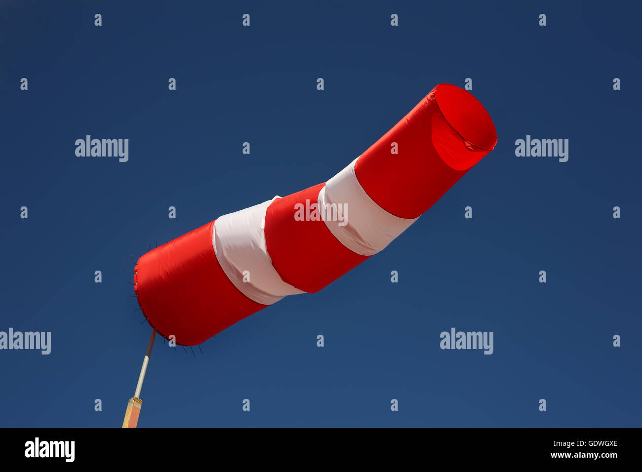 Boats parking - Wind direction indicator. Windsock the sky background. Wind west. - Stock Image