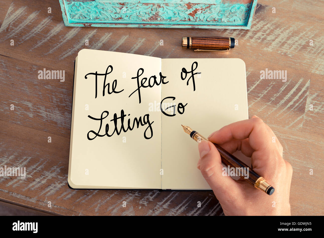 Handwritten text The Fear Of Letting Go as concept image. - Stock Image