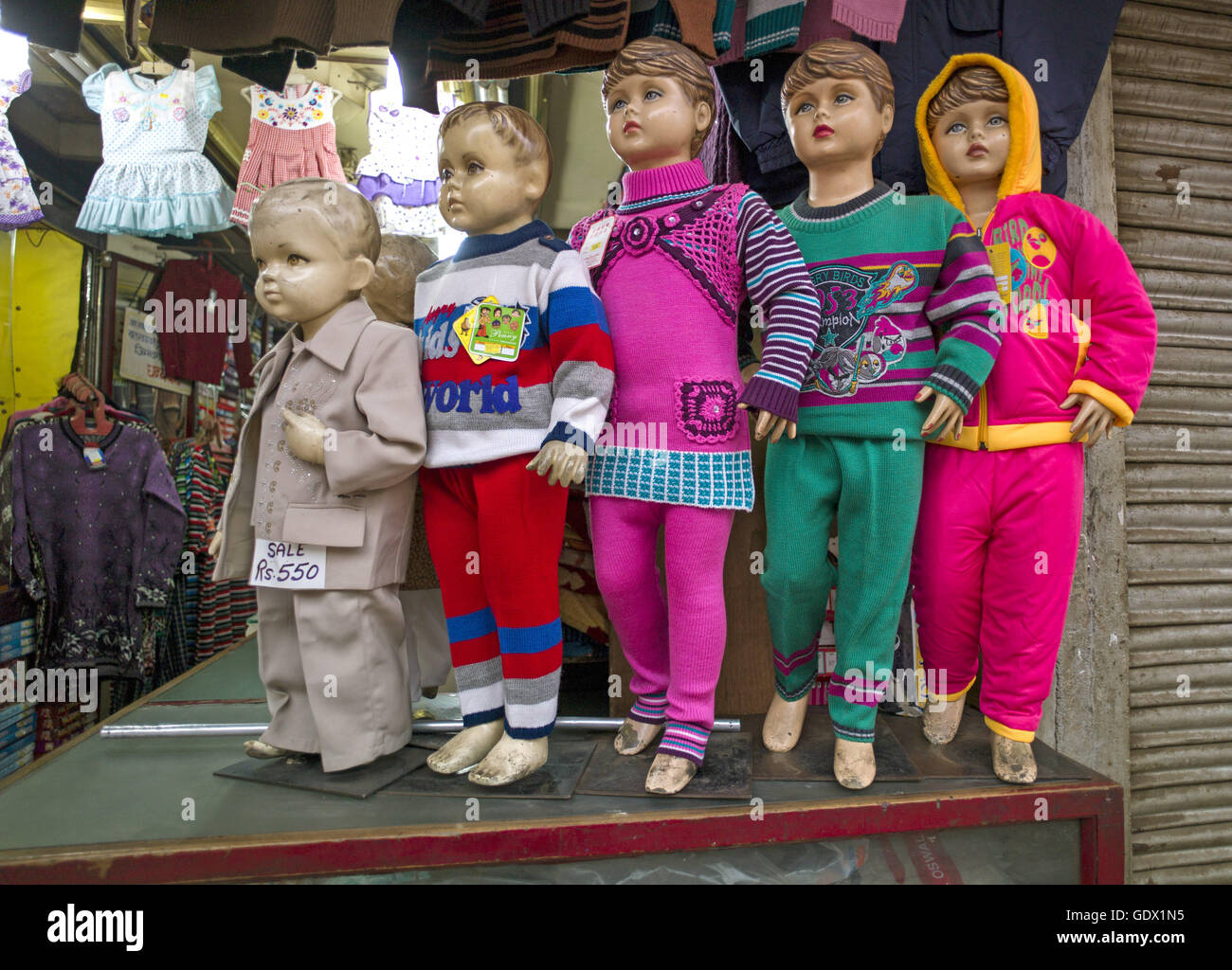 Children's clothing for sale at the Chandni Chowk market in New Delhi, India, 2014 - Stock Image