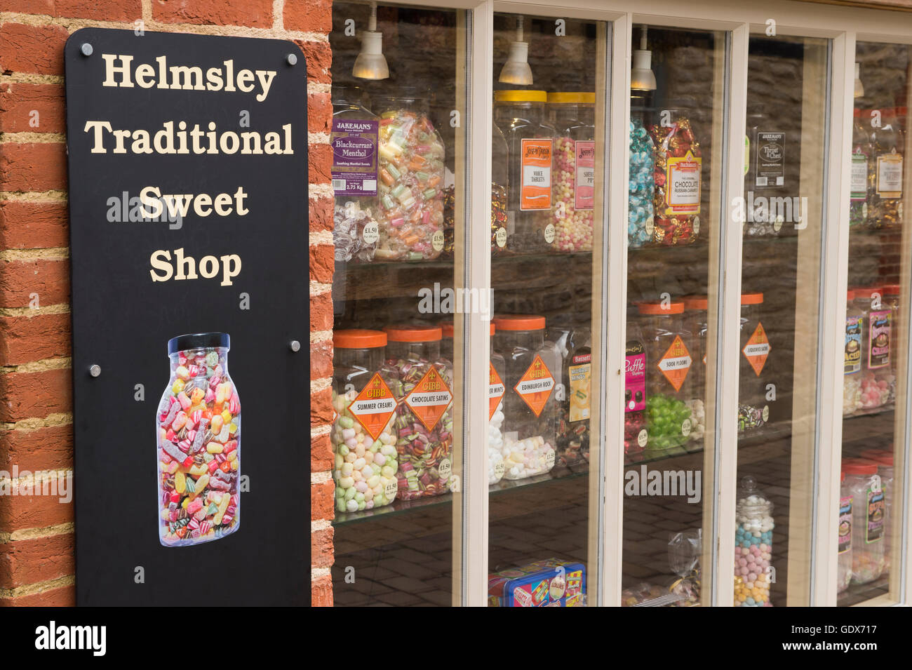 Helmsley Traditional Sweet Shop, Helmsley, North Yorkshire - close-up of sign and rows of sweet jars on display Stock Photo