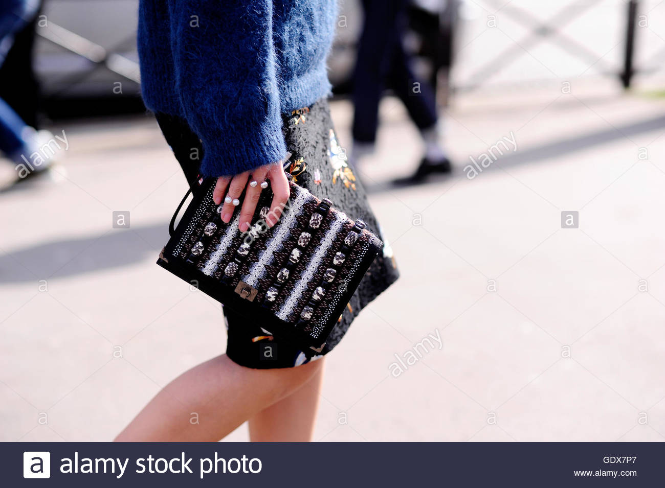 Detail of a woman with Clutch during Paris Fashion Week. - Stock Image