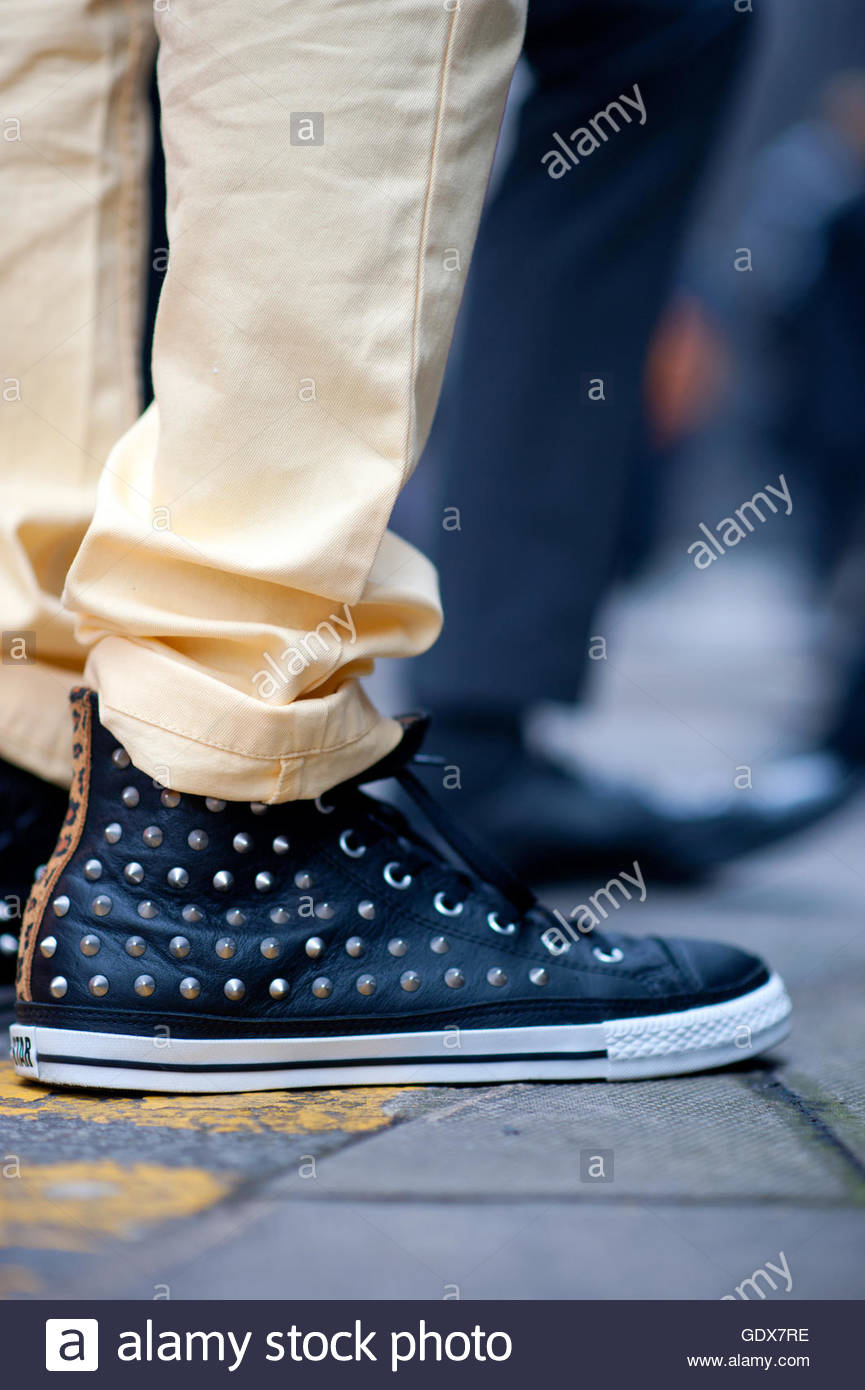 Converse designer sneakers on the street during Mens Fashion Week London,LCM. - Stock Image