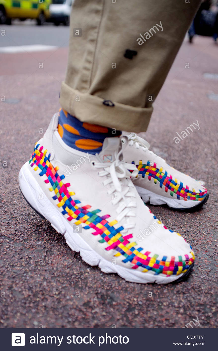 Weaved lace-up Moccasin Style mens footwear on New Oxford Street during London Fashion Week. - Stock Image