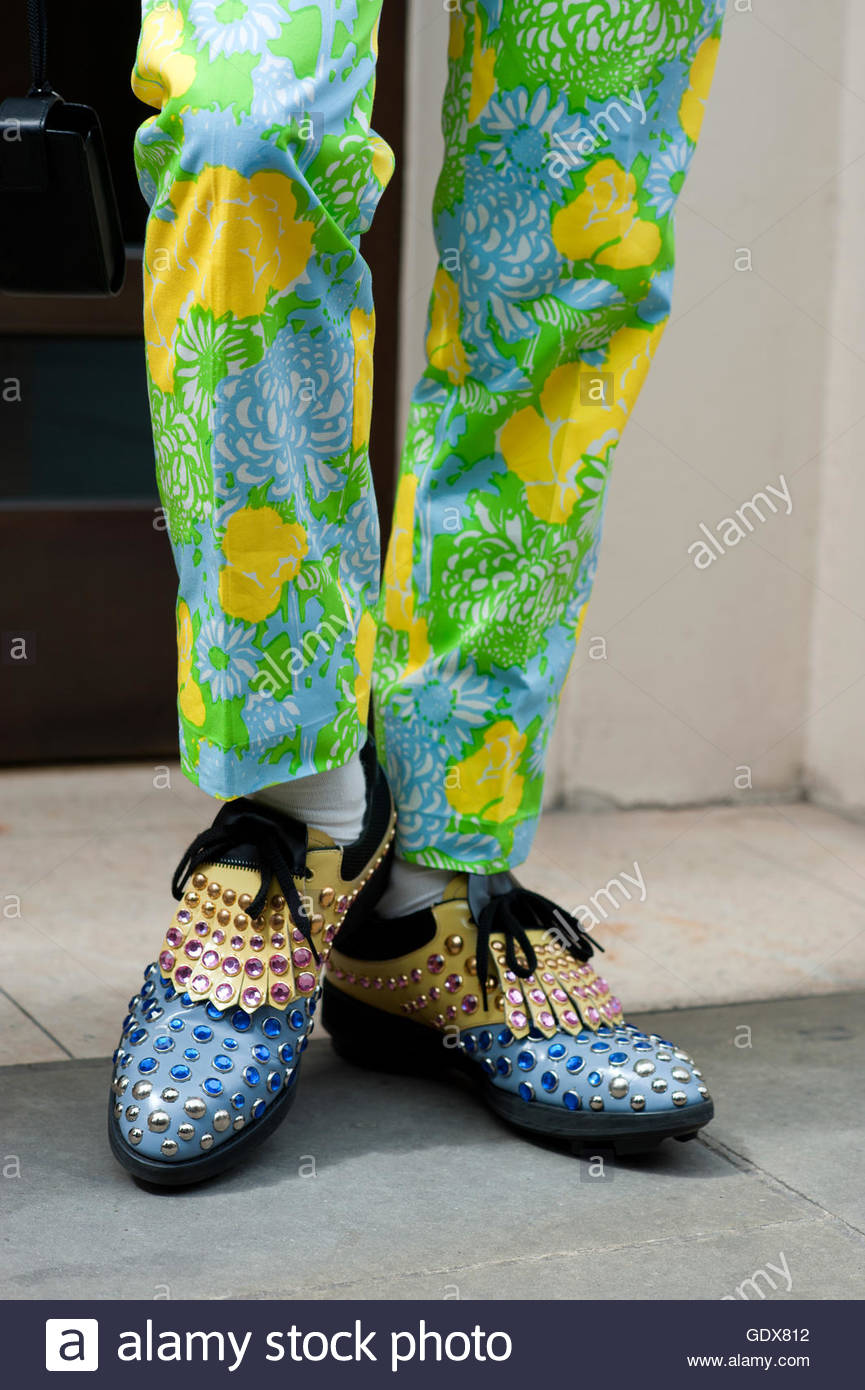 Detail of bright trousers with studded Prada shoes. London. Stock Photo