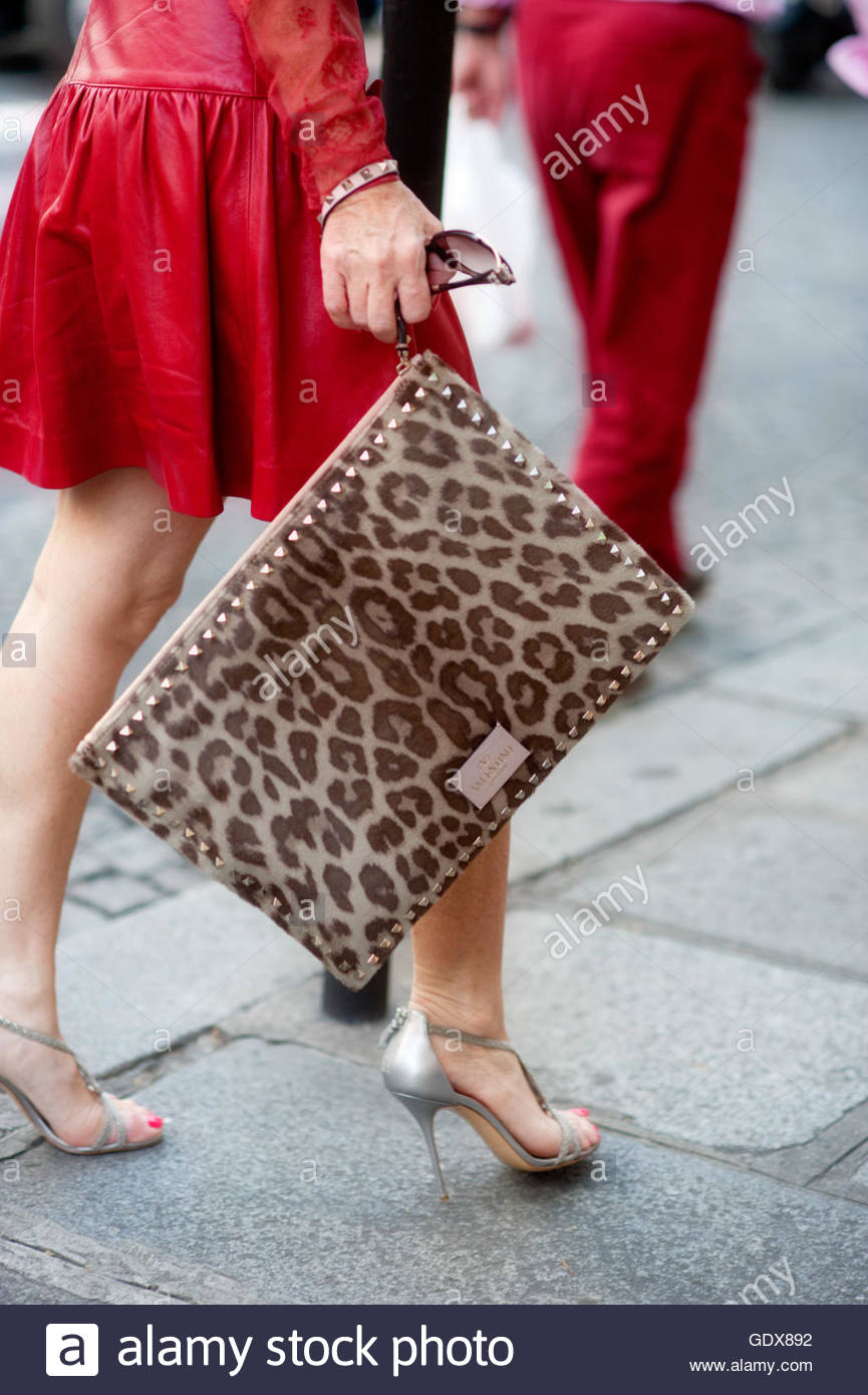 Woman with Oversize leopard print clutch, Paris Fashion Week. - Stock Image