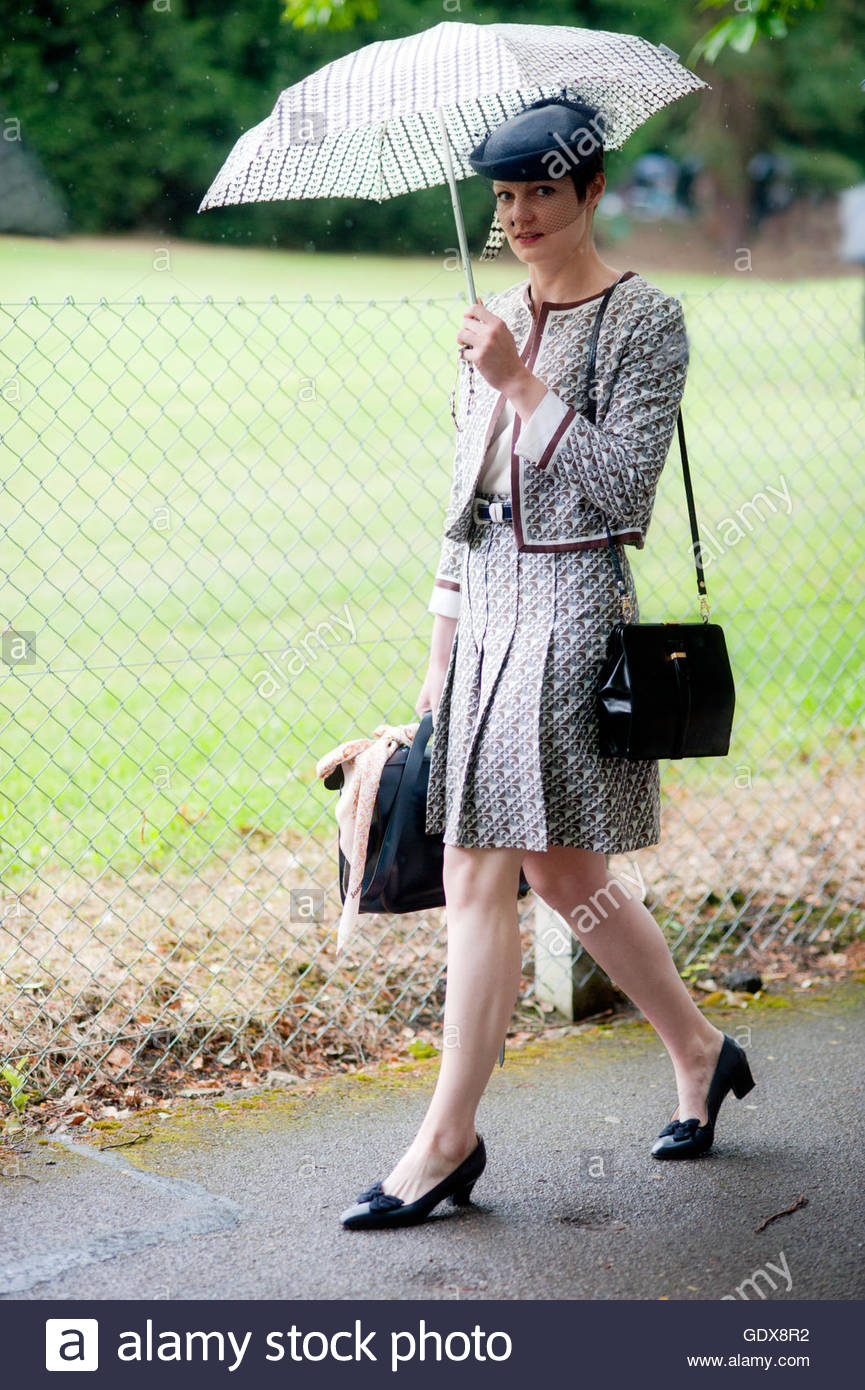 Arrival for Ladies Day in the rain wearing Chanel, at Royal ascot, Berkshire England. - Stock Image