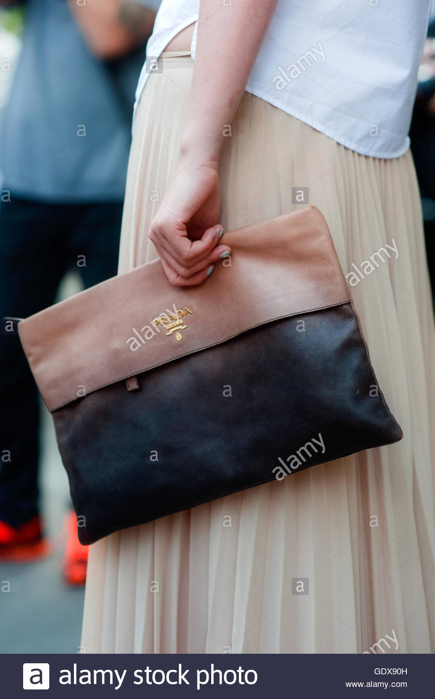 Detail of Women hold a clutch against her pleated skirt, Paris, during Paris Fashion Week. - Stock Image