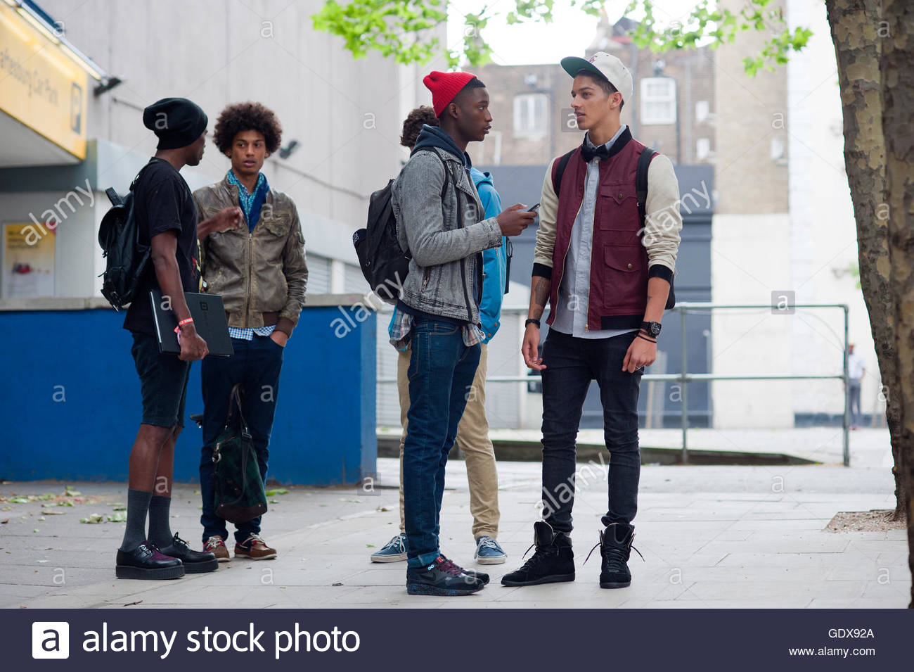 A group of Models Off Duty talking during Mens fashion Week London England UK. - Stock Image