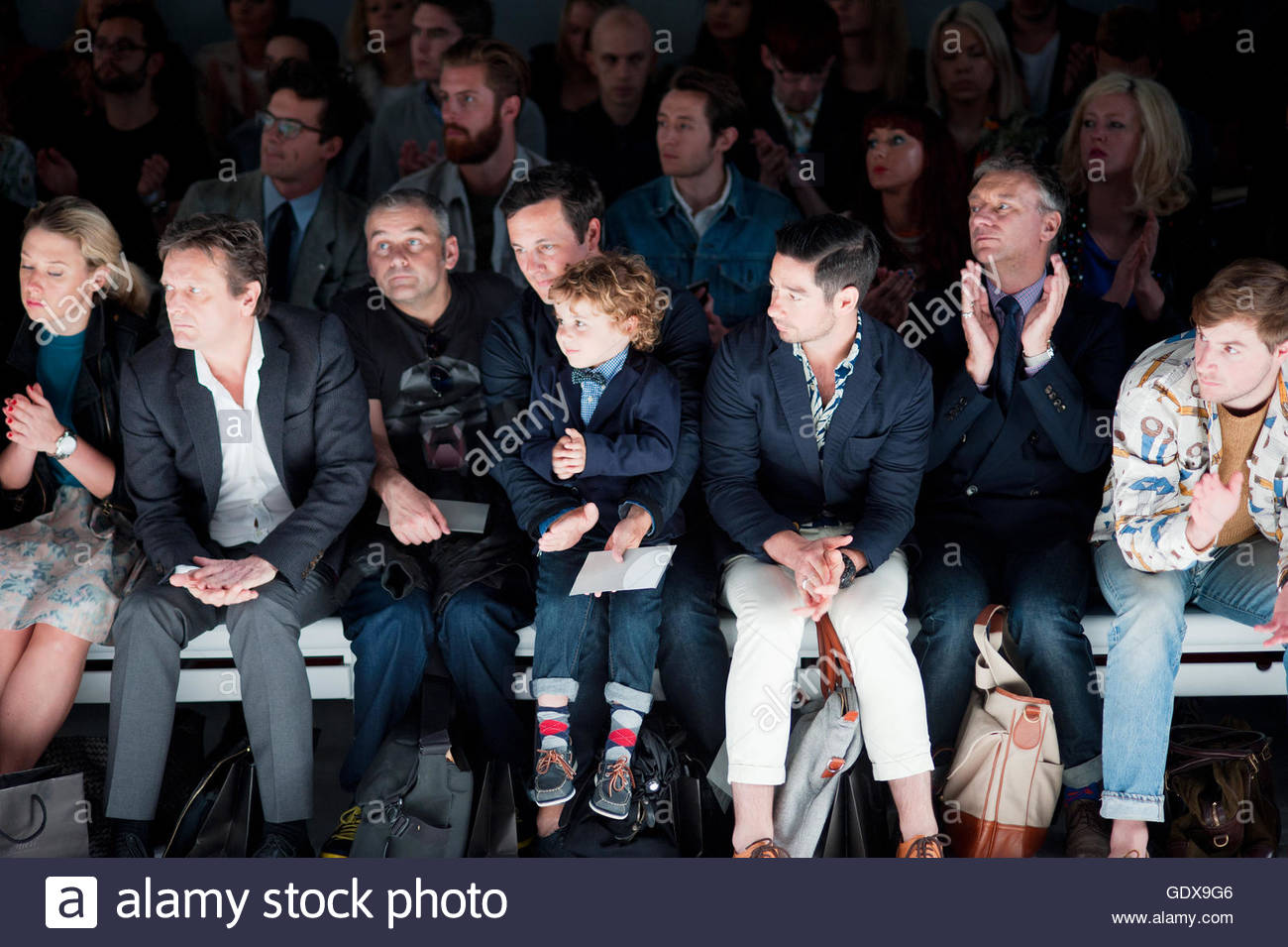 Front Row audience watching Fashion Show during London Mens Fashion Week. - Stock Image