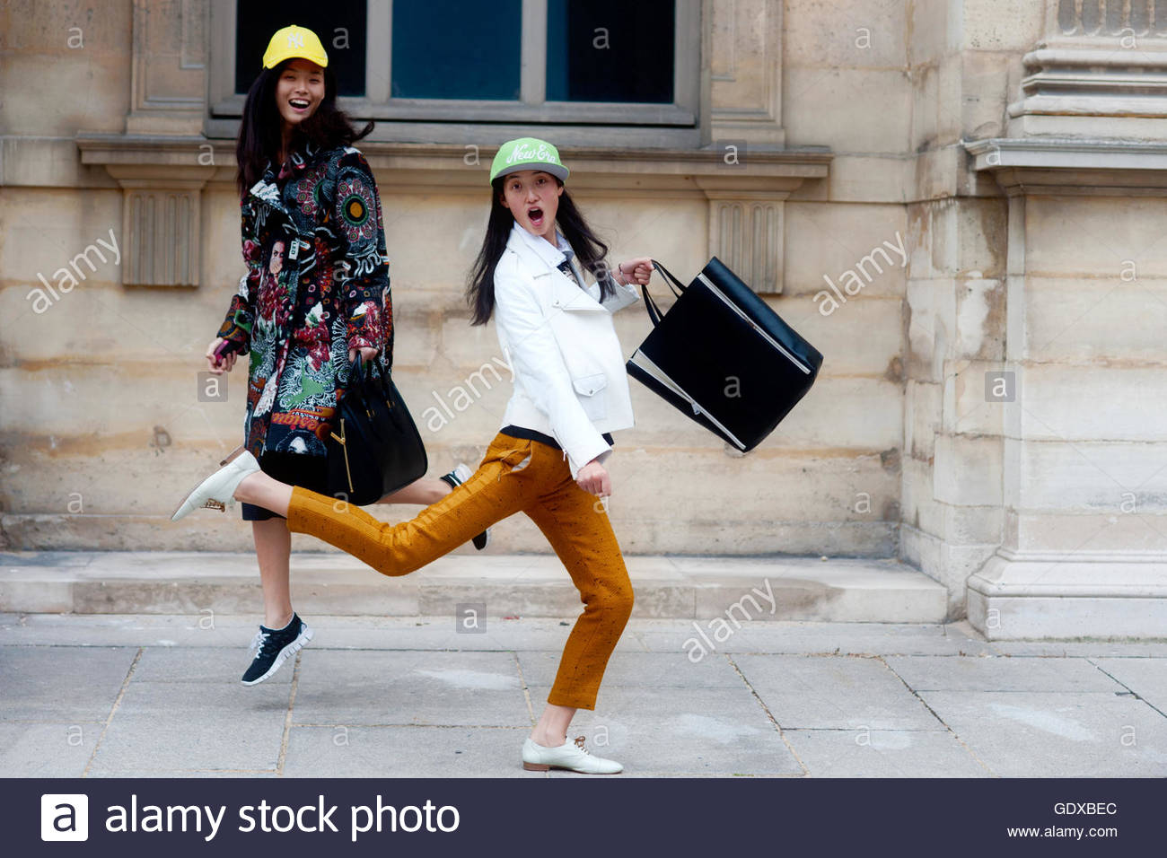 Models Tian Yi and Lina Zhang after the Louis Vuitton ready to wear Fashion Show at the Louvre Palace, Paris. - Stock Image