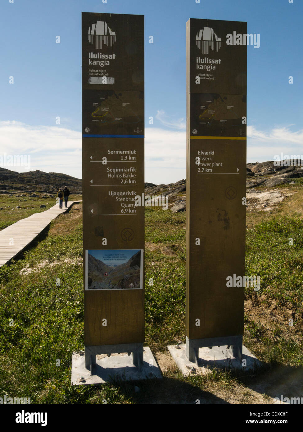 Information boards at start of a boardwalk to Ilulissat icefjord is a town in Qaasuitsup municipality in western - Stock Image