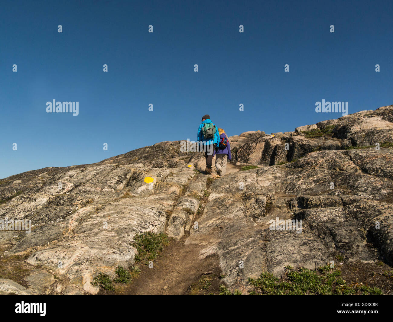 Ilulissat is a town in Qaasuitsup municipality in western Greenland   lovely July summers day couple walking on - Stock Image