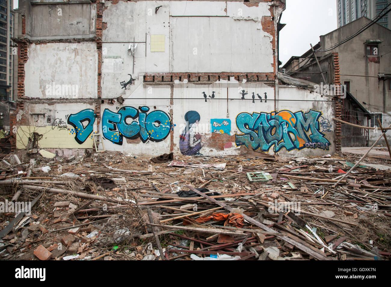 Street art on walls of demolished building. - Stock Image