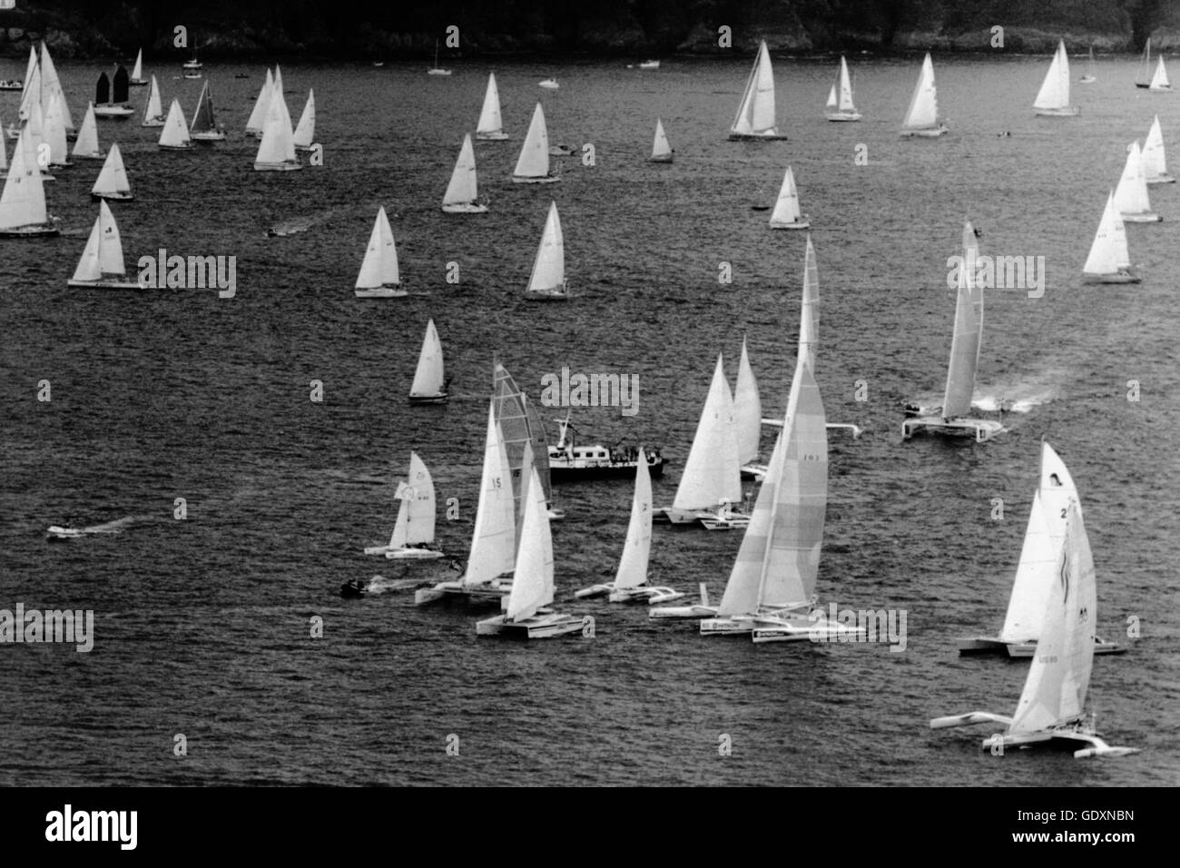 AJAXNETPHOTO. 5TH JUNE, 1988. PLYMOUTH, ENGLAND. - CARLSBERG RACE 1988 - FLEET AT THE START - 90 BOATS IN TOTAL - Stock Image