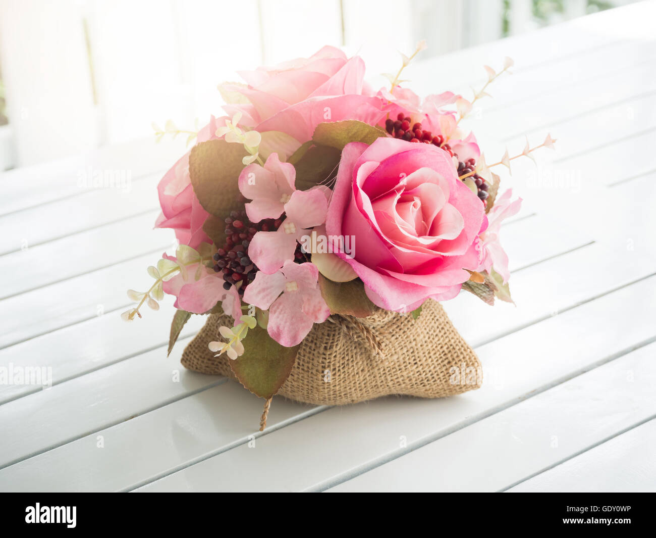 Bouquet Of Beautiful Artificial Flowers On White Wooden Table In A