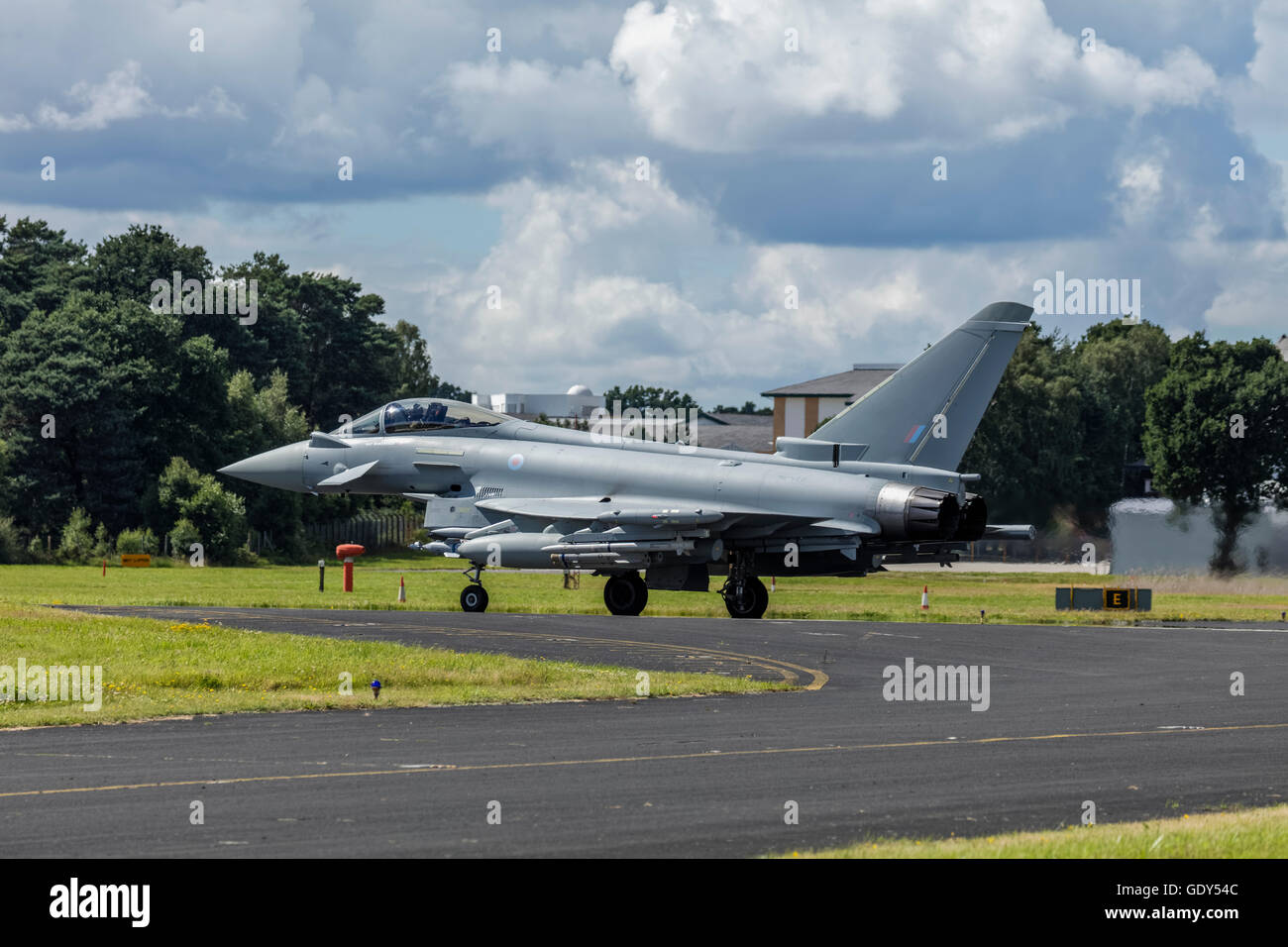 RAF Eurofighter Typhoon air plane on the tarmac of the runway at Farnborough airport after landing at the Farnborough - Stock Image