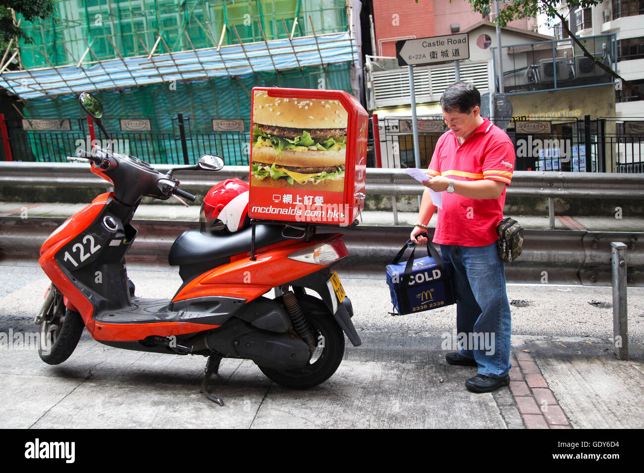 McDonalds delivery scooter in Kowloon, Honk Kong, China - Stock Image
