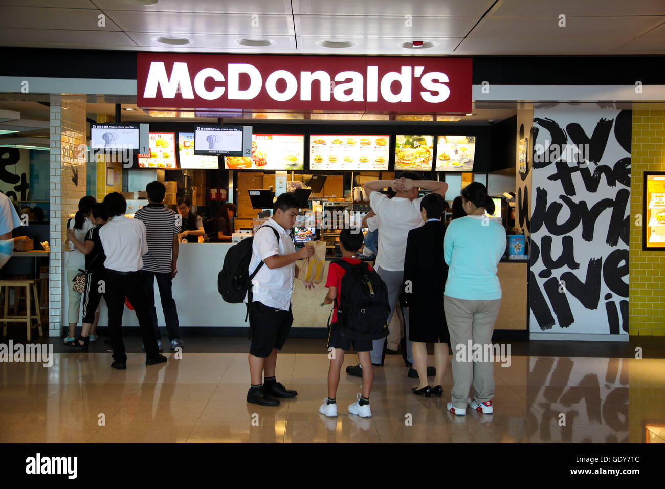Chinese teenagers queuing in McDonalds Kowloon, Honk Kong, China - Stock Image