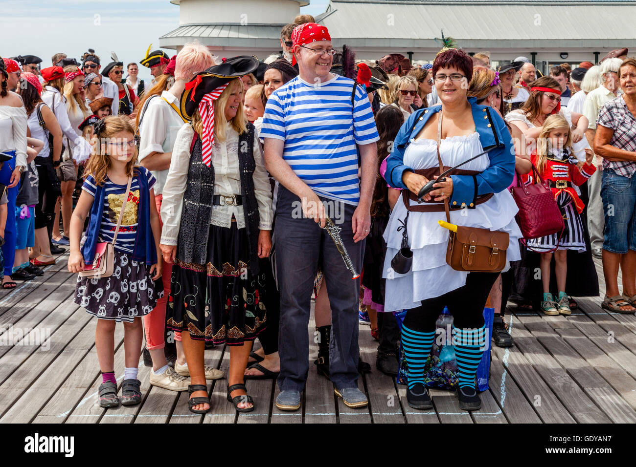 People Dressed In Pirate Costumes Pose For A Group Photo On Hastings Pier During The Hastings Pirate Day Festival Hastings UK  sc 1 st  Alamy & People Dressed In Pirate Costumes Pose For A Group Photo On Hastings ...