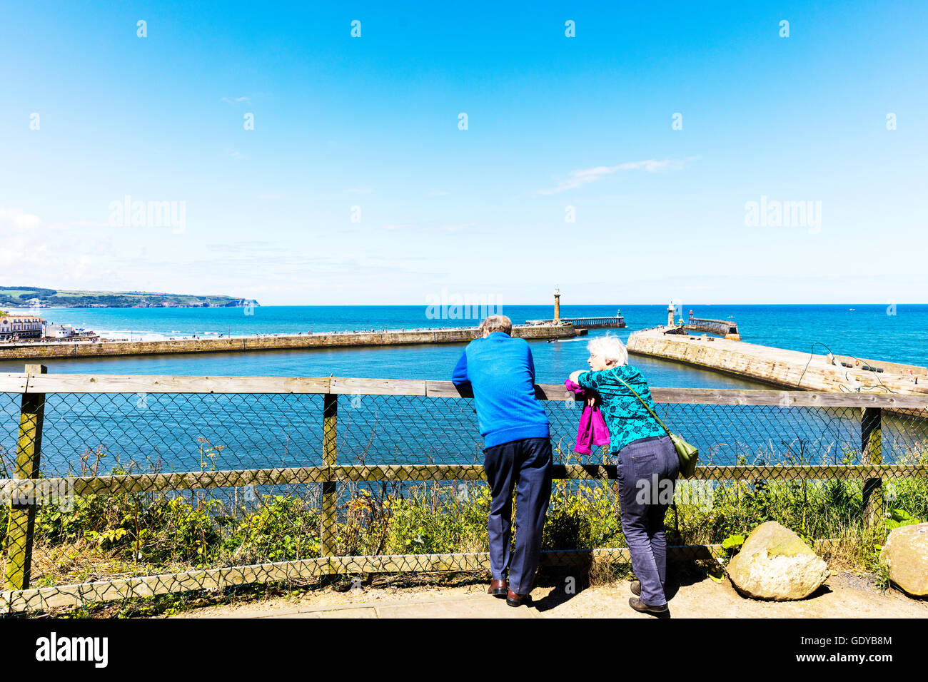 Old people reminiscing looking out to sea remembering better times past pastimes UK England GB - Stock Image