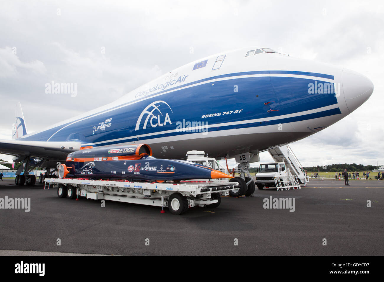 Blood hound speed record car next to Boeing 747 transporter aircraft - Stock Image