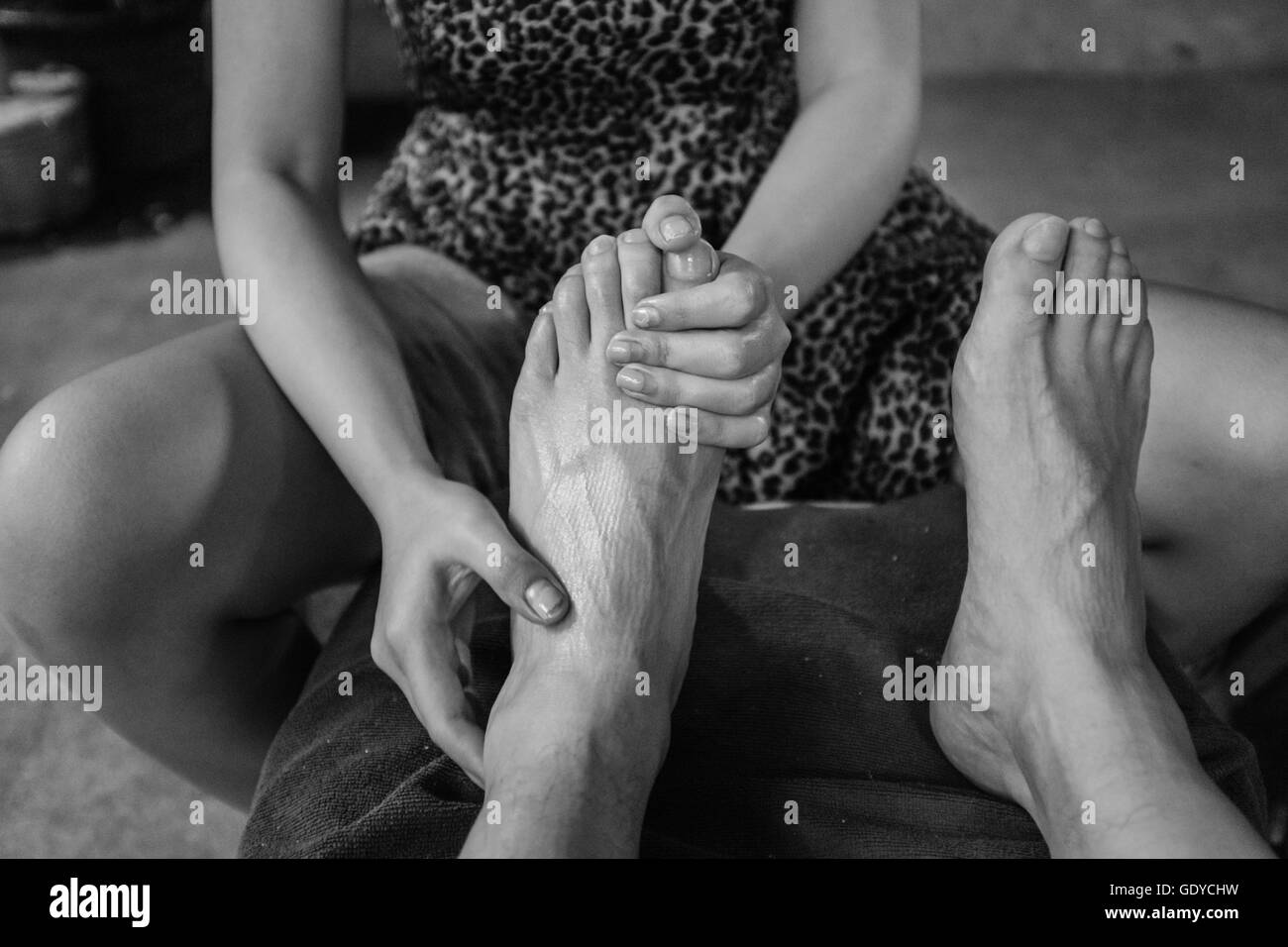 Foot spa, close up detail of feet being massaged,Chiang Mai,Thailand - Stock Image