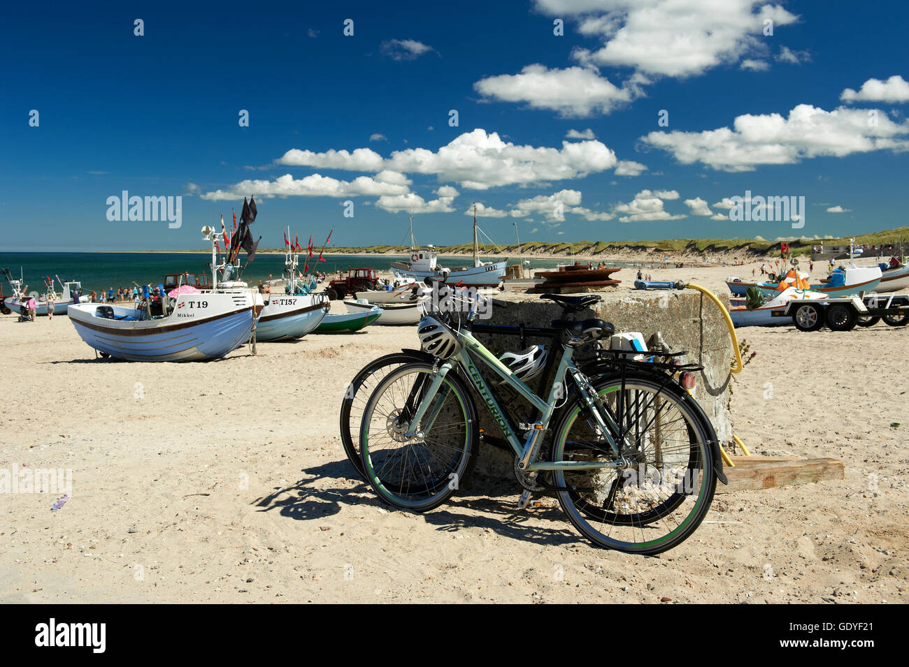 Bicycles parked at the beach with fishingboats landingplace in the background - Nr. Vorupoer (Nr. Vorupør), - Stock Image