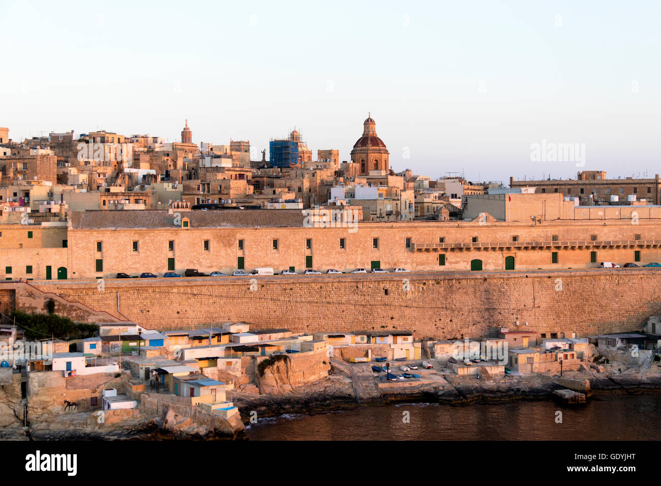 View of Malta's old town and fortifications bathed in early morning sun - Stock Image