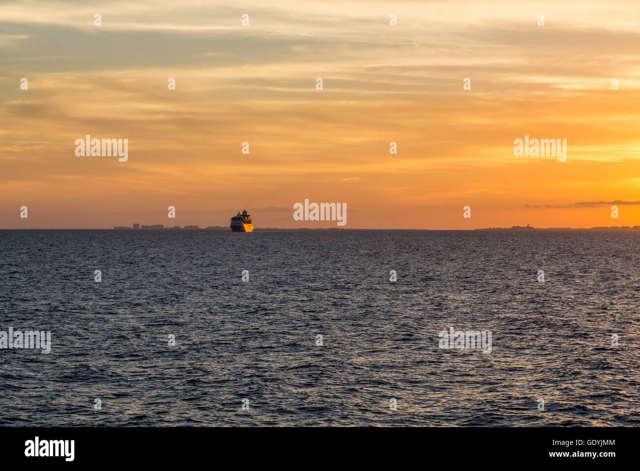 Miami Skyline At Sunset From The Sea With Freighter On Horizon