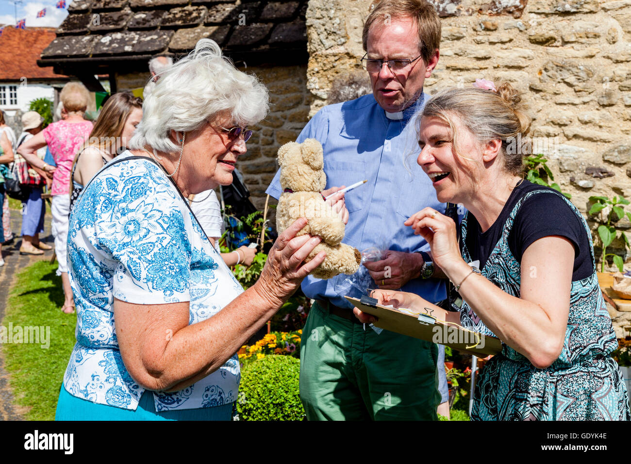 An Elderly Woman Enters A Teddy Bear Into The Prettiest Teddy Bear Competition, West Chiltington Summer Fete, Sussex, - Stock Image