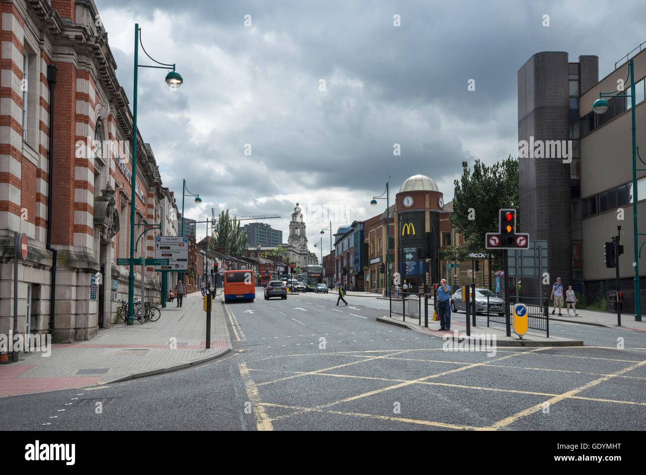 Road junction on the A6 in the town of Stockport, Greater Manchester. Stockport library, royal mail and town hall. - Stock Image