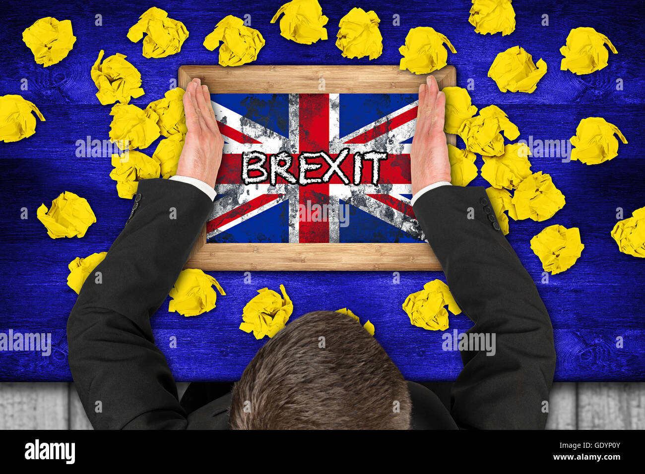 brexit concept on blue table with yellow paper snarls  politican and brexit chalkboard - Stock Image