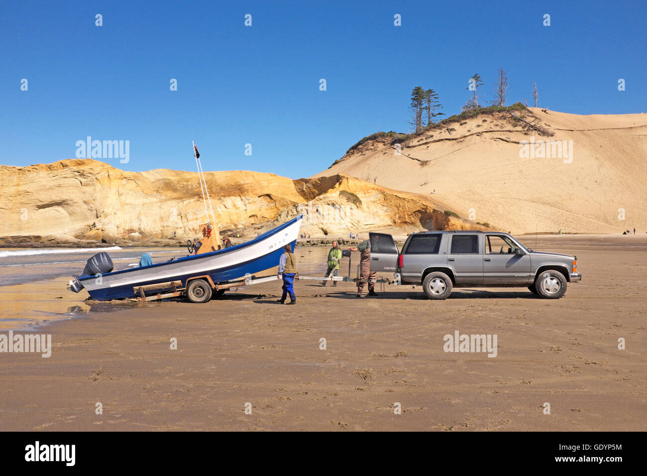 A dory fisherman stands near his boat on the beach at Pacific City, Oregon, home of the Pacific city Dory Fleet. - Stock Image