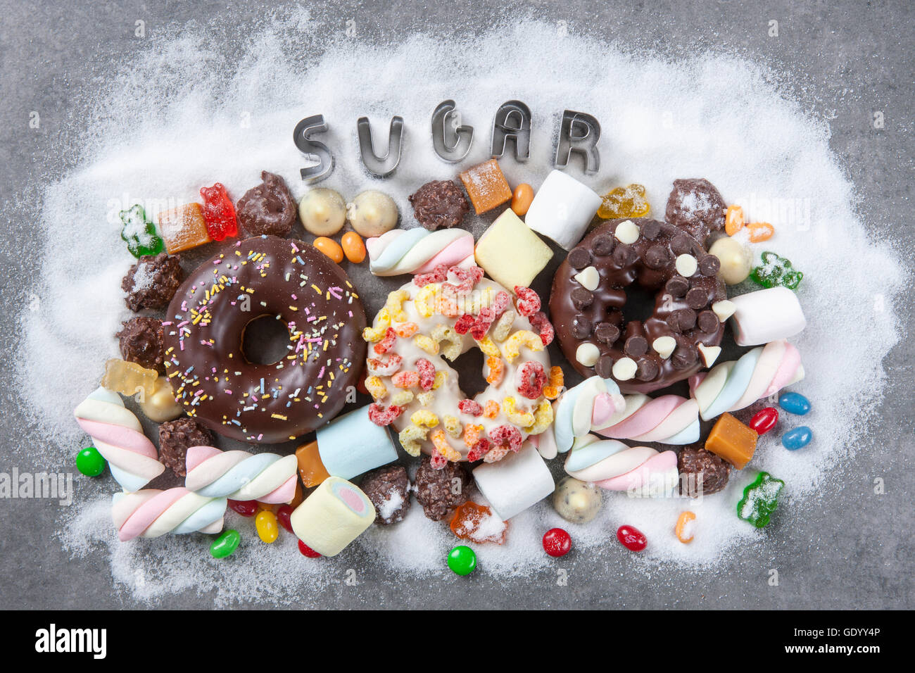 Typographical word of SUGAR and various sweet food - Stock Image