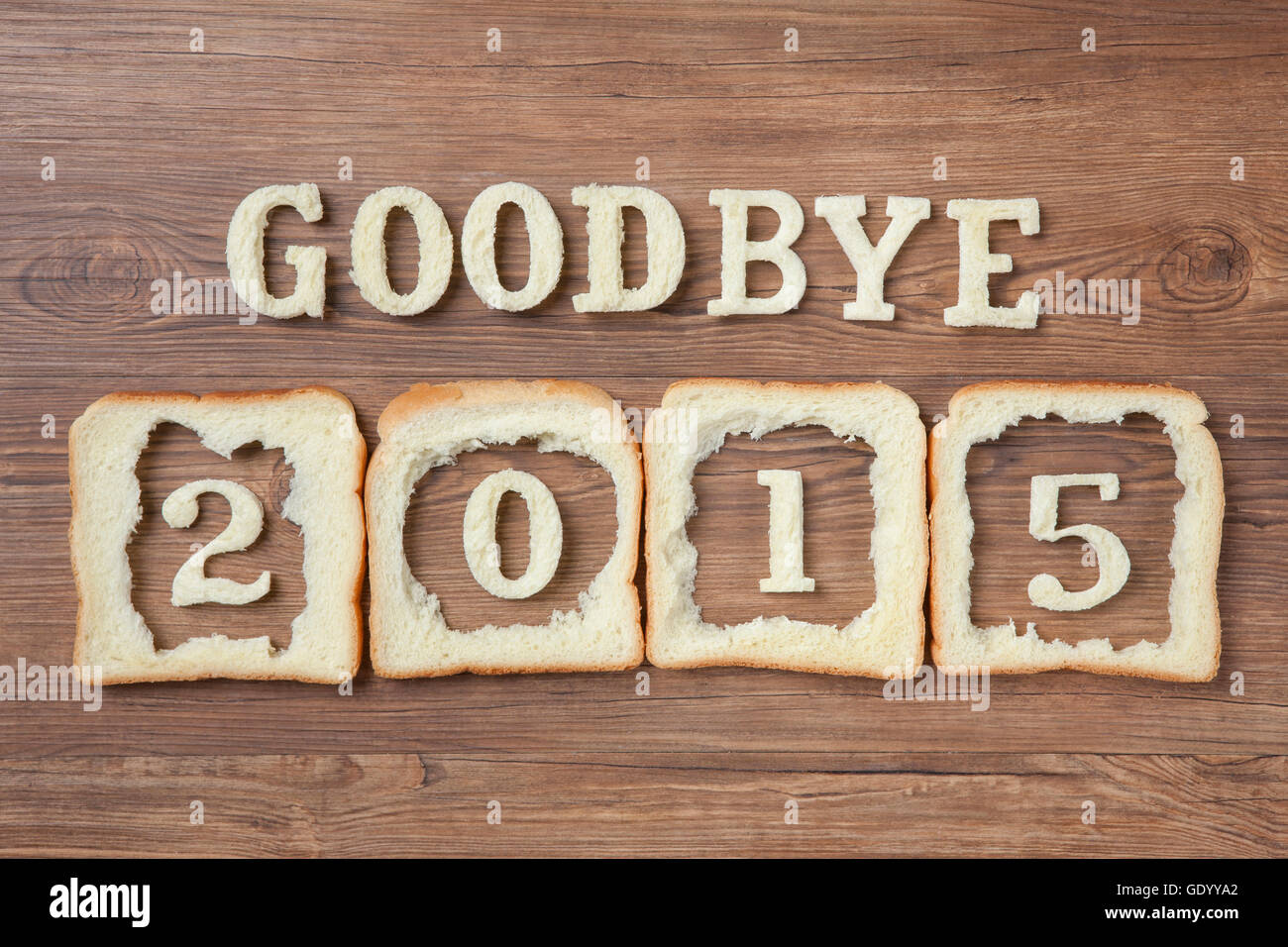 Typographical message of GOODBYE 2015 made of bread - Stock Image