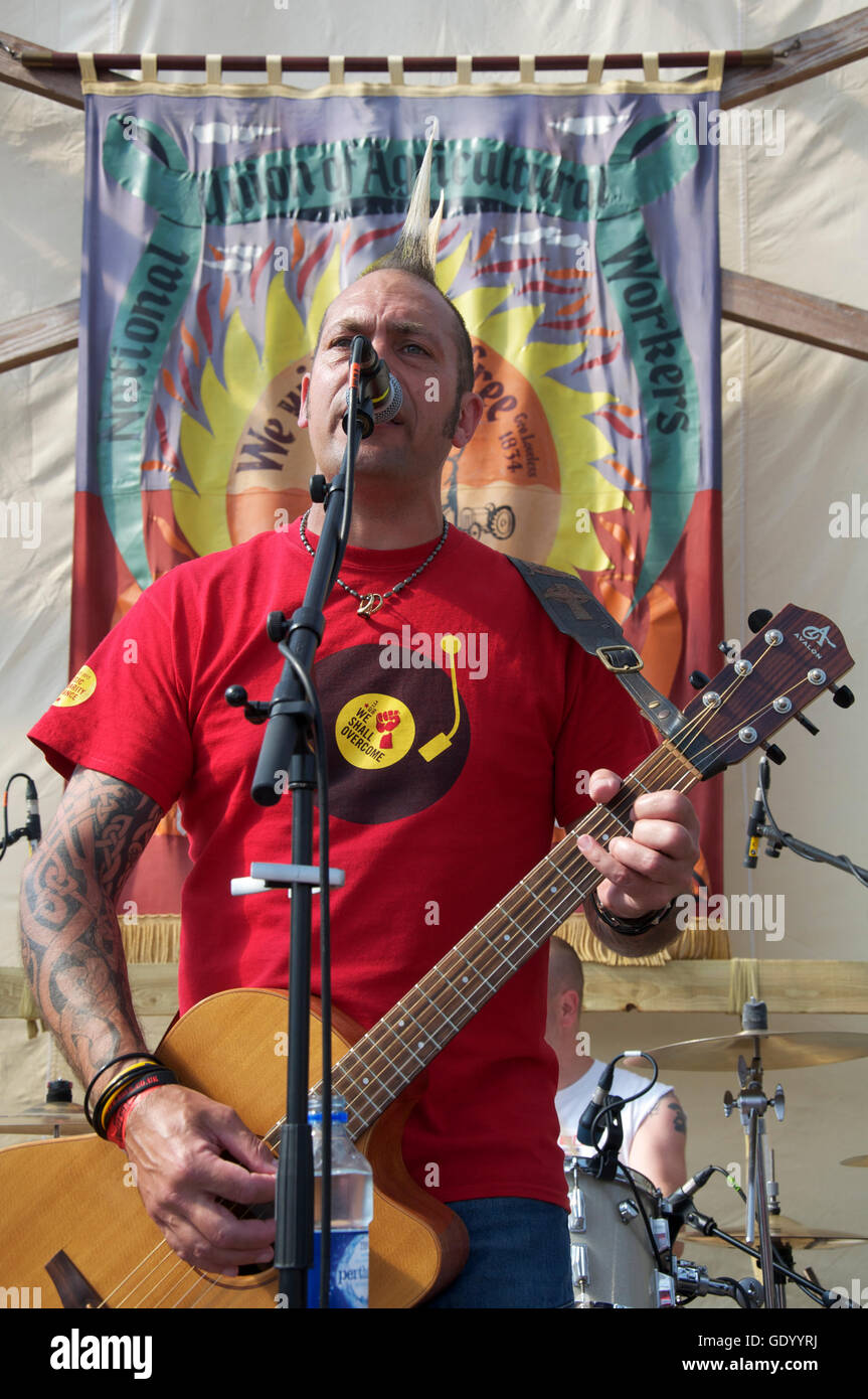 "Ken Bonsall, lead singer and guitarist of Folk Punk band ""Ferocious Dog"" performing at the 2016 ""Tolpuddle Martyrs Stock Photo"