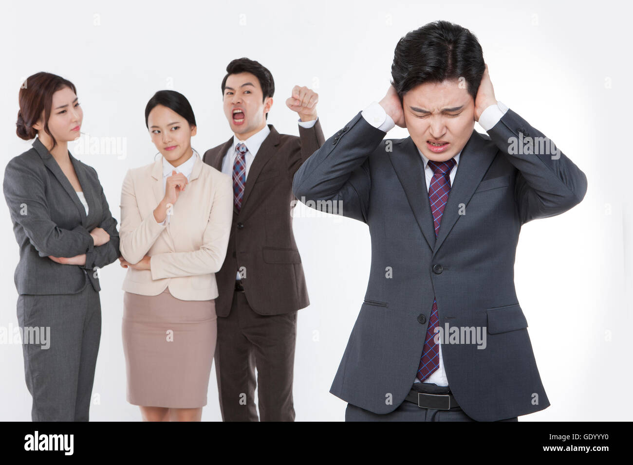 One stressful business man excluded by his coworkers - Stock Image
