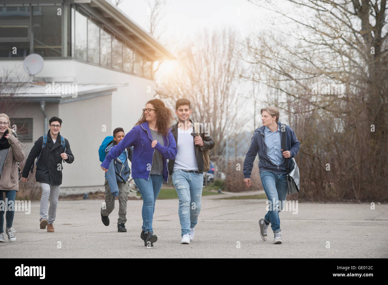 University students leaving school building, Bavaria, Germany - Stock Image