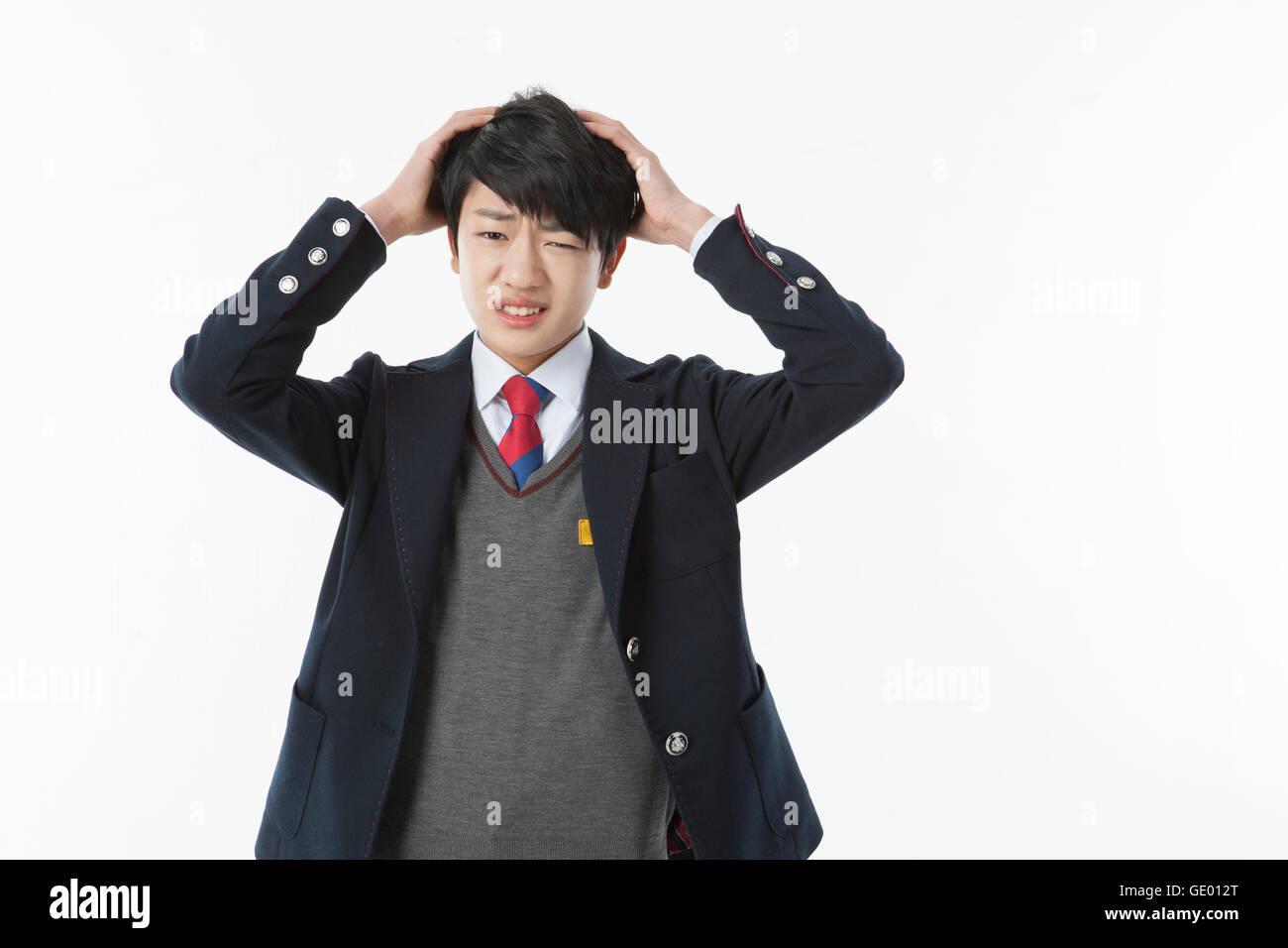 Portrait of stressful school boy - Stock Image