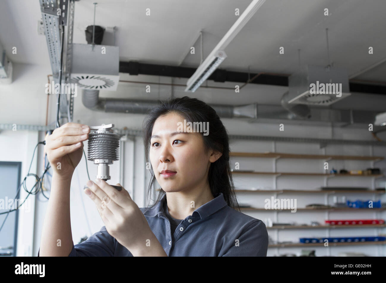 Young female engineer working in an industrial plant, Freiburg im Breisgau, Baden-Württemberg, Germany Stock Photo