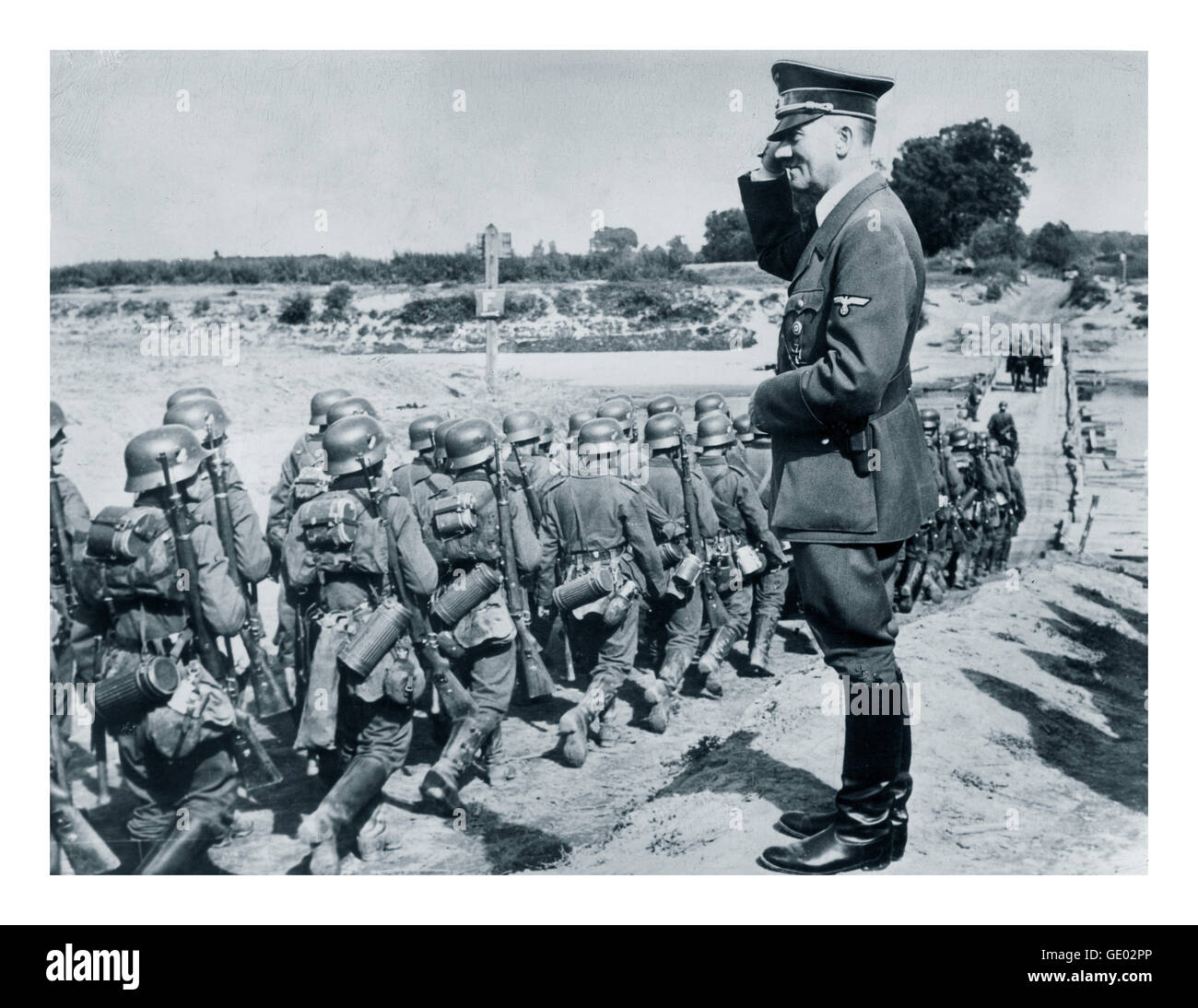 GERMAN INVASION POLAND Adolf Hitler saluting marching Wermacht troops during occupation of Poland WW2 - Stock Image