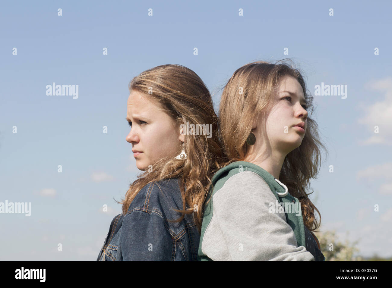 Teenage girls looking in different ways, Freiburg im Breisgau, Baden-Württemberg, Germany - Stock Image