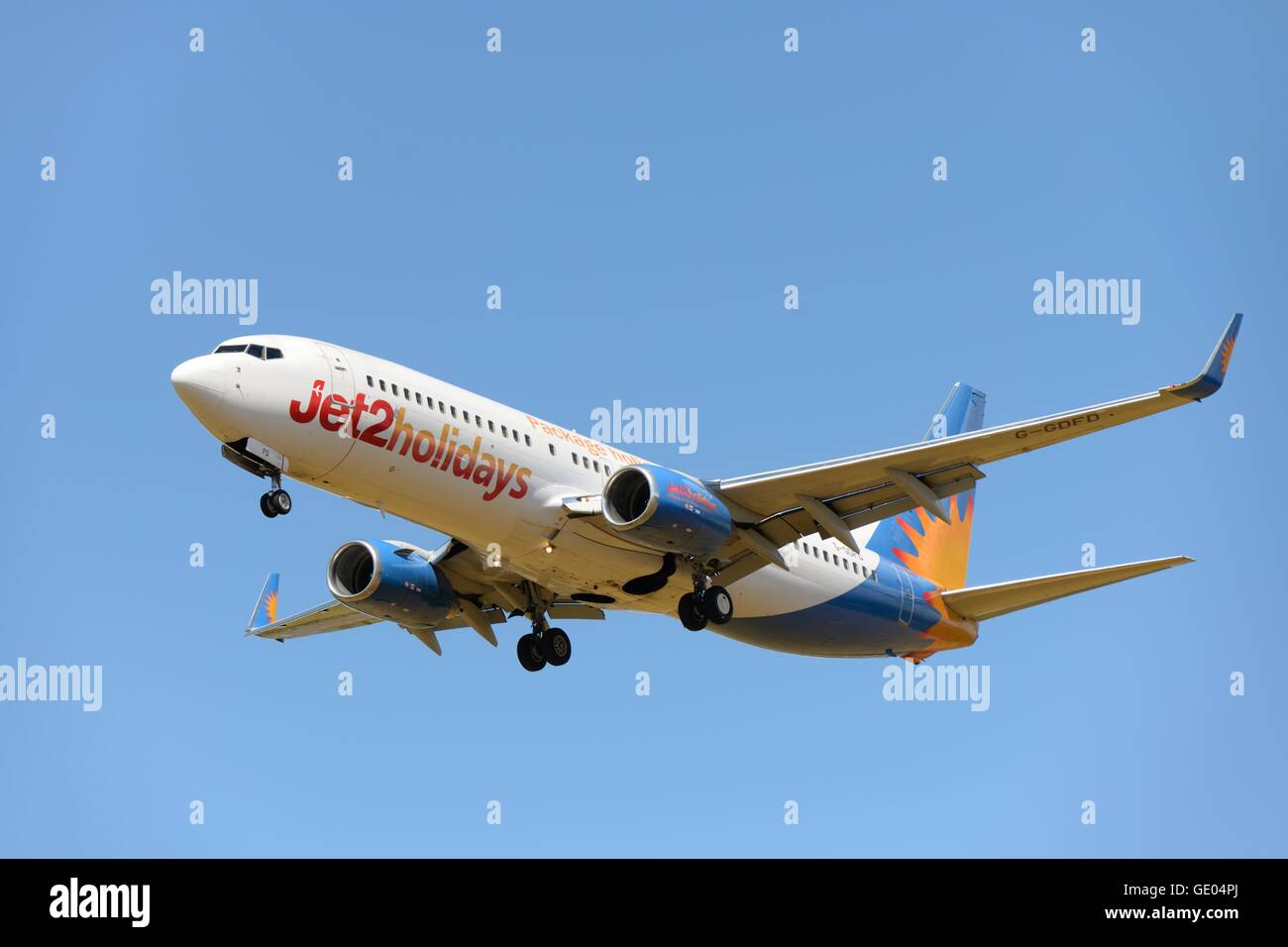 A Jet 2 Holidays aircraft on final approach to airport in Glasgow, Scotland, UK - Stock Image