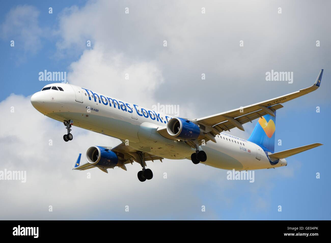A Thomas Cook aircraft on final approach to airport in Glasgow, Scotland, UK - Stock Image