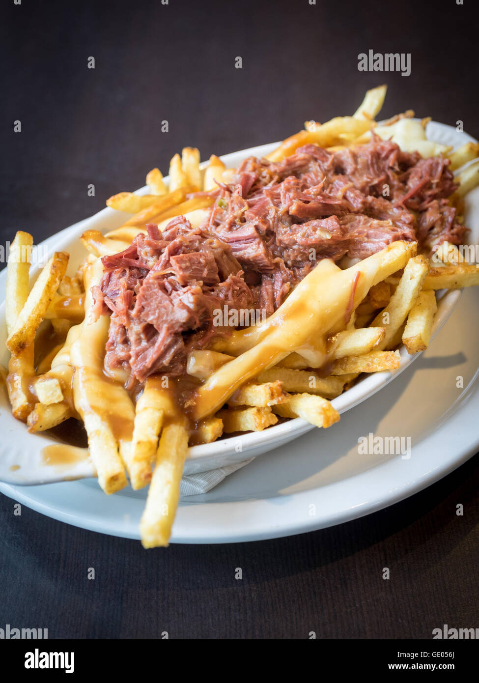 A hearty dish of beef brisket poutine from Urban Diner in Edmonton, Alberta, Canada. - Stock Image