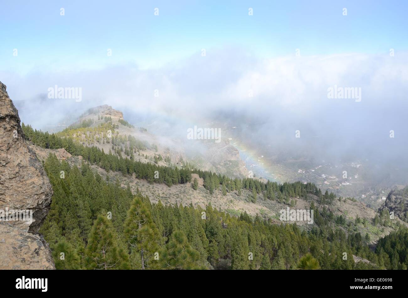 Rain bow, mountains, Gran Canaria, hiking, forest, trees, rocks, stone, panorama, clouds, mist - Stock Image